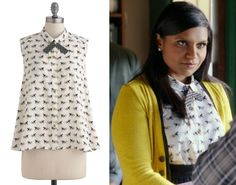 If you don't have shared custody of a tote bag to discuss, I think conversational prints can be the perfect ice breaker. And Mindy's cute horse print top with gold buttons and a contrasting necktie from The Mindy Project episode 1.02 would make a great meet-cute, or certainly great attire for one. Canter Hardly Wait Top - $37.99