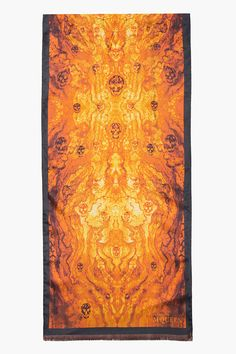 "ALEXANDER MCQUEEN //  Gold and amber woodgrain and skull silk scarf  32259M010009  Rectangular silk scarf in tones amber and gold. Woodgrain and signature skull graphic print throughout one face. Fringed edges. Approx. 52"" length, 13"" width. 100% silk. Dry clean. Made in Italy.  $290 CAD"
