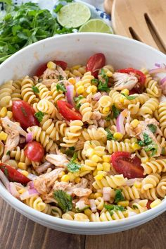 EASY BBQ Chicken Pasta Salad - this yummy pasta salad recipe is full of corn, tomatoes and chicken and dressed with a BBQ sauce vinigarette!