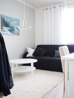 Concrete and glass pendant lamp in oceanic living room. Laaka I Laura Väre