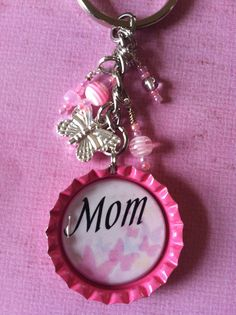 Hey, I found this really awesome Etsy listing at http://www.etsy.com/listing/113621060/new-lower-price-mom-bottle-cap-key-chain