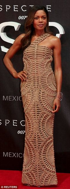 Golden girl: Naomie joined her on the red carpet in her semi-sheer number