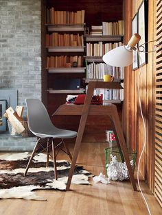 A cozy corner library.  Primary Desk | Designed by Nathan Yong