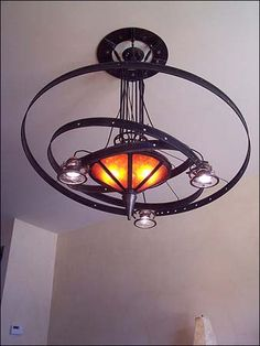 the Orrery Chandelier: a hand-made steampunk styled lamp. $4,000.00, via Etsy.--another great upcycled lamp!