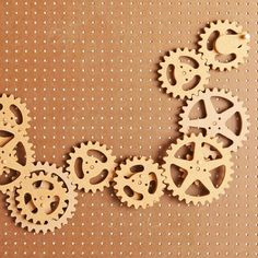 Scrollsawn Gears  Turn the kids loose with a pile of these scrollsawn gears and let their imagination run through an infinite number of spinning setups and creative configurations. Each gear sits atop a movable gear based and mount to perforated hardboard. Full-size patterns for all gears included.  Featured in November 2012 issue of WOOD.