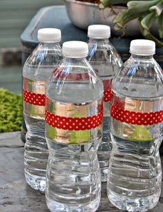 Cover water bottle labels with duct tape and decorate with washi tape