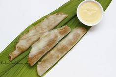 Sweet Rice Dumplings Steamed In Turmeric Leaves. (Patholi in Konkani) A thin layer of rice batter is spread out on a turmeric leaf, a sweet jaggery-coconut filling is placed all along the center of the leaf. They're closed & steamed to make delicious patholi. They're served hot with ghee on top. A heavenly dessert from Konkani cuisine. While patholis are steamed, your house fills up with an amazing aroma of turmeric leaves. Turmeric leaves impart their aroma to patholis & make them delish.