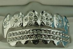 """Grillz with Fangs. I would look like """"Jaws"""" from the James Bond movie wearing that."""