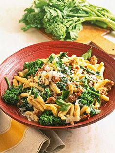 Broccoli rabe has a slightly bitter yet delicious taste that blends beautifully with spicy Italian sausage in this pasta recipe.