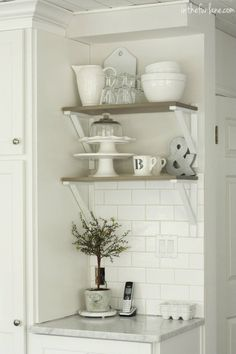 Ikea shelf brackets spray painted.. in the Fun Lane: The Kitchen Chronicles