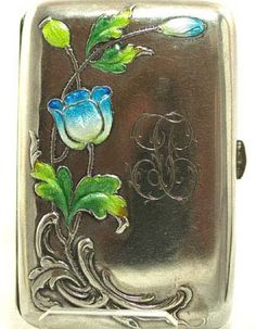 """Austrian Art Nouveau silver cigarette case decorated with enamel in vivid blue and green in a floral motif and heavily washed in gilt. It measures 2 ¼"""" x 3 ½"""" and is fully hallmarked A1 for Austrian sterling ~ circa 1910."""