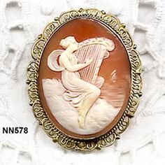 Late Victorian Detailed Shell Cameo  Pin/Pendant Of Woman Playing A Harp Overlooking The Sea Set In Gold Over Silver Frame  c.1880