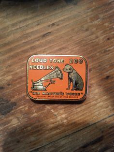 vintage (1920s/30s?) His Masters Voice Gramophone Needle Tin. I have one red, and one orange. The only difference between