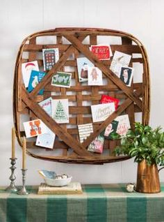 Show off the influx of season's greetings on a vintage tobacco basket by tucking well wishes into th... - Courtesy of Burcu Avsar
