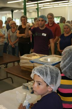 Feed My Starving Children partners with H4H.  FMSC director demo'sthe how to's of this highly systematic process.  Very cool to see in action!