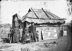 Simmons' (miners' office, mining agent, law agent and public accountant) and family outside his bark hut, Gulgong area, 1871-1875 / American & Australasian Photographic Company | by State Library of New South Wales collection