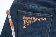 A guide for hand embroidering on denim. I love this touch of geometric color on a jeans pocket!