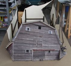 If It's Hip, It's Here: Small Scale Models of Decaying Homes Built and Photographed by Ofra Lapid.