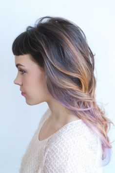 30 Lavender Hair and Purple Hair Styles- this one keeps the natural brunette and balayages in bits of peach and lavender. The chunky caramel streaks are pretty too.