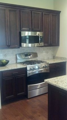 Kitchen - dark cabinets, light counters