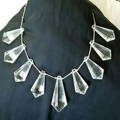 Crystal prism necklace - like new Statement piece with acrylic crystal prisms on silver metal tubing with bead spacers. Adjustable lobster clasp closure. Measures 15 inches at longest. Never worn, like new. Banana Republic Jewelry Necklaces