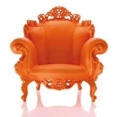 Orange Proust by Alessandro Mendini -- it's not exactly a simple wooden chair, and it's not subtle . . .but what a backdrop for a dressing gown in pinks and some marabou slippers! (Also, this chair would not be overwhelmed by a feather boa. Just saying.)