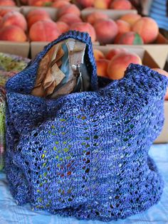 Ravelry: February Market Bag pattern by Sarah Wilson.  Constructed with an enveloping pouch at the base of the bag, this is worked seamlessly in the round with just one skein of fingering weight yarn.