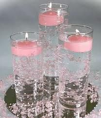 Pink candle center piece.With purple and green candles instead?