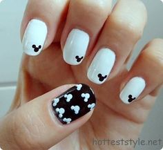 Disney Nails.....Love it!  Paint four nails white and one black then thake a q-tip or toothpick dip it in black nail polish then make three dots (in the shape of a mickey mouse head) in the corner of the white nails and then do the same with white nail polish but in rows on the black nail......Good Luck!