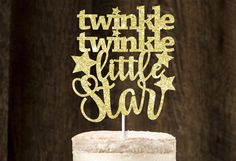 Twinkle Gold Glitter Cake Topper Add a sparkle* to your homemade delicious cakes! Our cake toppers are perfect addition to any celebration! *Made of quality glitter cardstock. *Name adhered to one or two cake sticks. *Single-sided, white cardstock at the back. *All cake toppers