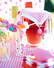This easy punch can be made right before serving. To keep the bees from buzzing around the punch pitcher, tiny water balloons anchor a cloth cover: Clip them to the corners of a handkerchief; hang larger ones along the tablecloth to keep it from blowing away.