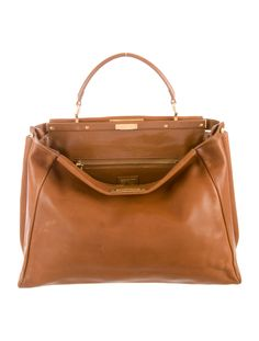 Cognac leather Fendi Peekaboo bag with mixed hardware, optional shoulder strap,single flat top handle, dual compartments, cognac leather and suede interior, single pocket at interior wall with zip closure and dual turn-lock closures at top. Includes dust bag. Shop authentic designer handbags by Fendi at The RealReal.