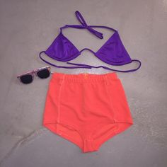 Urban Outfitter's high waisted shorts/bikini top This combo is perfect for the beach! The bikini top is not Urban Outfitters but looks amazing with the shorts. Pair with sunglasses and you're beach ready! Urban Outfitters Swim