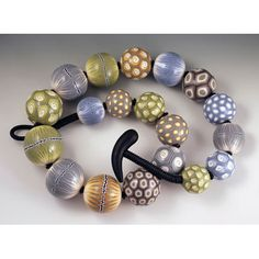 Big Bead Necklace in Shades of Grey, Yellow-Ochre, Soft Greens and Blues.. $665.00, via Etsy.