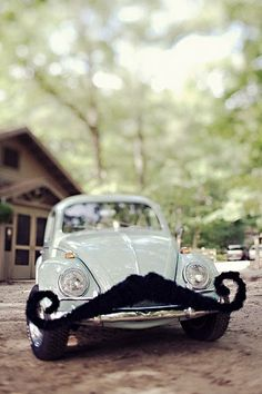 Minty moustached car.