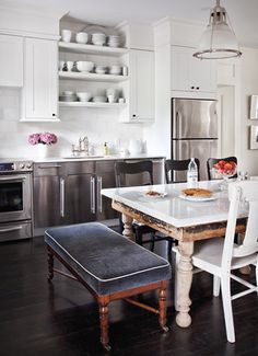 Kitchen. marble-topped table. mixed seating and textures.
