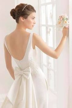 Code 601: Boat neck pique slim a-line, scoop back, buttons over zip. Delicately beaded lace appliqué at fitted bodice.