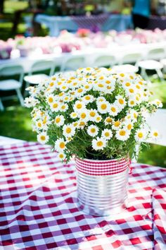 EASY summer entertaining centerpiece table idea. Can, ribbon and inexpensive wild flowers. Love. More fabulous ideas via Kara's Party Ideas KarasPartyIdeas.com