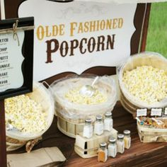 A popcorn bar would be perfect for a family night OR a party! Rustic Popcorn Bar by Pen N'Paperflowers Popcorn Bar Party, Gourmet Popcorn, Popcorn Station, Popcorn Stand, Snack Station, Popcorn Balls, Popcorn Toppings, Snack Bar, Popcorn Flavours