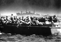 Landing barges loaded with U.S. troops bound for the beaches of Leyte island, in October 1944, as American and Japanese fighter planes duel to the death overhead. The men aboard the crafts watch the dramatic battle in the sky as they approach the shore.