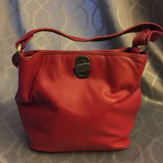 The SAK leather purse Soft leather red SAK purse. Shows little sign of wear on the bottom(pic 3) the rest of it is in like new condition. ❤️ The Sak Bags