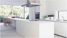 If you are a fan of simplicity in kitchen design then you should take a look at this beautiful kitchen called the <strong>Bulthaup B1 Kitchen</strong>. This modern kitchen collection is in a class of its own and worth some serious consideration if you're looking for a minimal super stylish white kitchen that packs a punch. To be honest I think that there is to much white in this kitchen, but I have to admit that it looks awesome when everything is clean. Pared down to the essentials, perfect