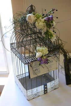 wishing well birdcage decorated with spring flowers and dodda vine  jade mcintosh flowers