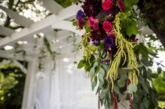 Rustic flowers, wine theme, arch decor, wedding flowers, Betina's at Parkview
