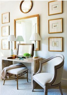 Like this arrangement of mirrors flanked by matted frames and sofa table