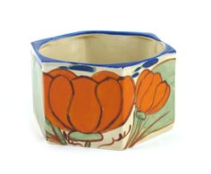 'Orange Lily' a Clarice Cliff Fantasque Bizarre Eve bowl, painted in colours printed factory marks, 12cm. diam.