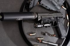 Sig P220 Dark Elite with silencer by Highway0311, via Flickr