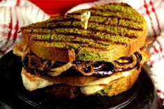 Caramelized eggplant and onion grilled cheese on Pullman loaf-style bread made with foraged lambsquarter seed and leaf flour