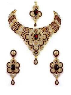 Refreshing look gold plated brass metal necklace with diamantes, stones work. Item code : JPD82195 http://www.bharatplaza.com/new-arrivals/jewellery.html
