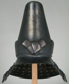 Military helmet with purple lacing and decoration in the form of a headband, worn by Hosokawa Tadatoshi (1586–1641), Japan. Edo period (1615–1868), 17th century. Iron, paper, lacquer, braided silk. Eisei-Bunko Museum.